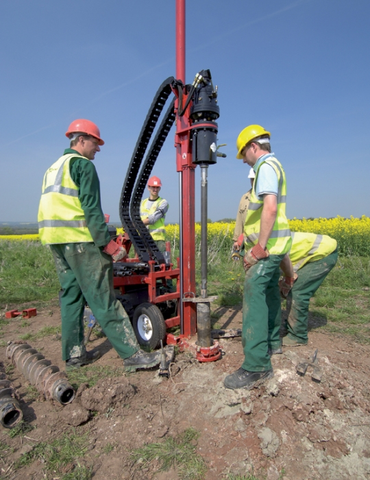 Engineers drilling in the field